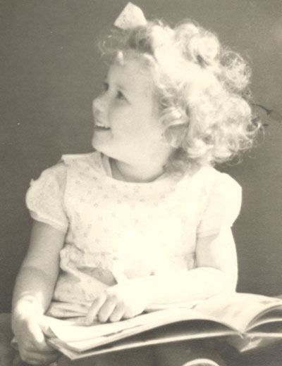 That's me, with my book at the age of three.